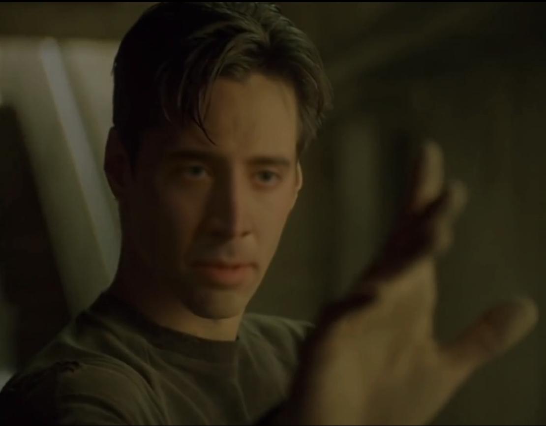 Neo transformed in Nicolas Cage.